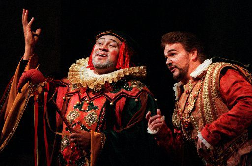 Gordon Hawkins (left), as  'Rigoletto, and Marcus Haddock as 'The Duke of Mantua' in the Dallas Opera's 2001 production of Rigoletto at the Music Hall at Fair Park.