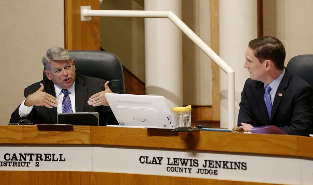 Commissioner Mike Cantrell (left), of District 2, and Dallas County Judge Clay Jenkins (right) speak during the Dallas County Commissioners Court in the county administration building in Dallas Tuesday August 5, 2014. (Andy Jacobsohn/The Dallas Morning News)
