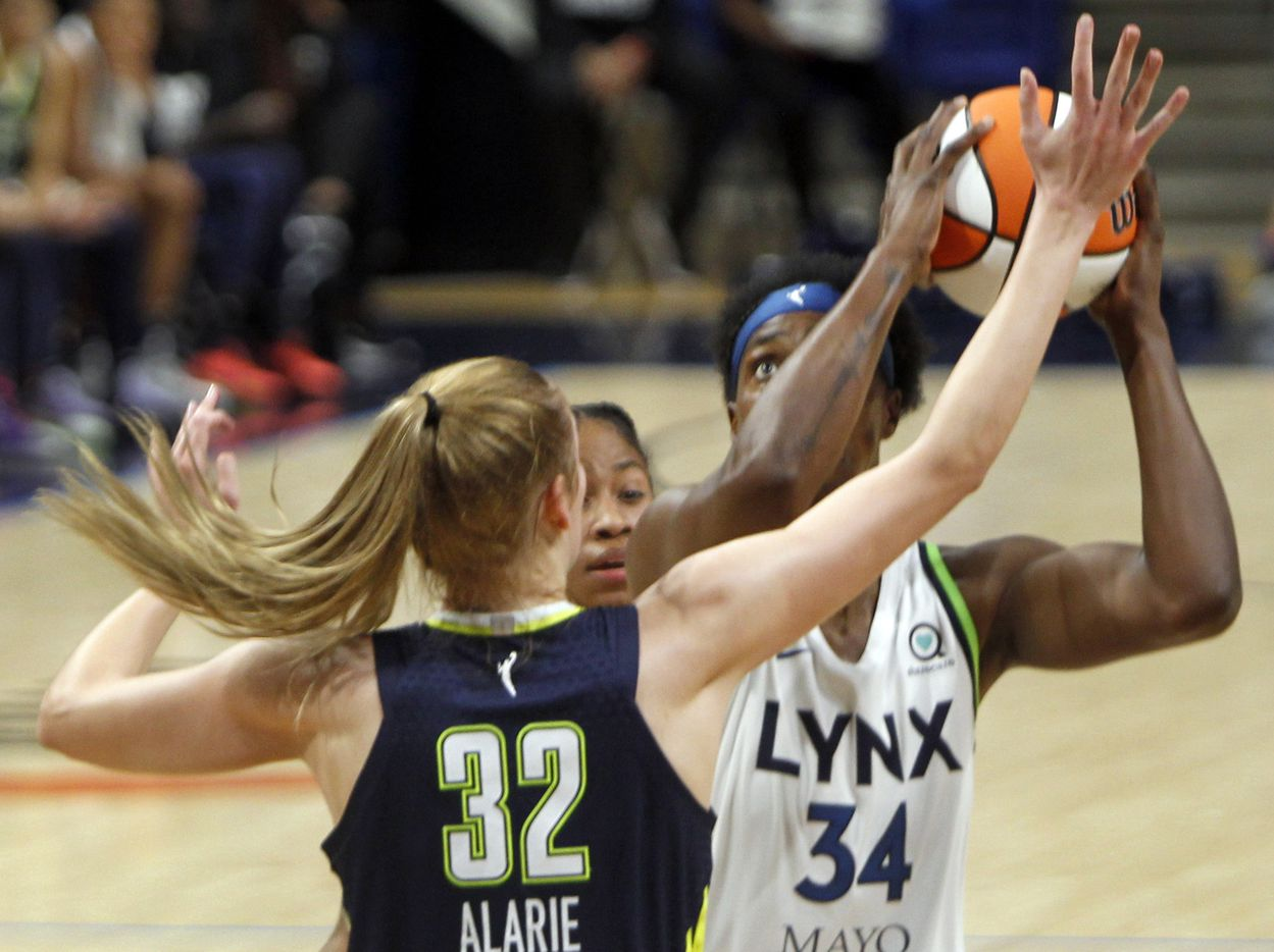Minnesota Lynx center Sylvia Fowles (34) eyes the basket as she drives the lane against the defense of Dallas Wings center Bella Alarie (32) during 2nd quarter action. The two teams played their WNBA game at College Park Center on the campus of the University of Arlington on June 17, 2021(Steve Hamm/ Special Contributor)