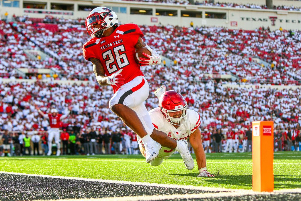 Texas Tech's Ta'Zhawn Henry (26) runs for a touchdown during an NCAA college football game against Houston, Saturday, Sept. 15, 2018, in Lubbock, Texas.