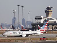 An American Airlines plane makes its way toward the runway before taking off at DFW International Airport on Nov. 16.