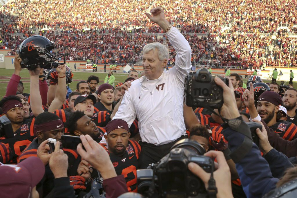 Virginia Tech head coach Frank Beamer is carried off the field by his players after an NCAA college football game in Blacksburg, Va., Saturday, Nov. 21, 2015.  North Carolina won the game 30-27 in overtime, but it was Beamer's last home game as coach since he is retiring at the end of the season.  (Matt Gentry/The Roanoke Times via AP) LOCAL TELEVISION OUT; SALEM TIMES REGISTER OUT; FINCASTLE HERALD OUT;  CHRISTIANBURG NEWS MESSENGER OUT; RADFORD NEWS JOURNAL OUT; ROANOKE STAR SENTINEL OUT; MANDATORY CREDIT
