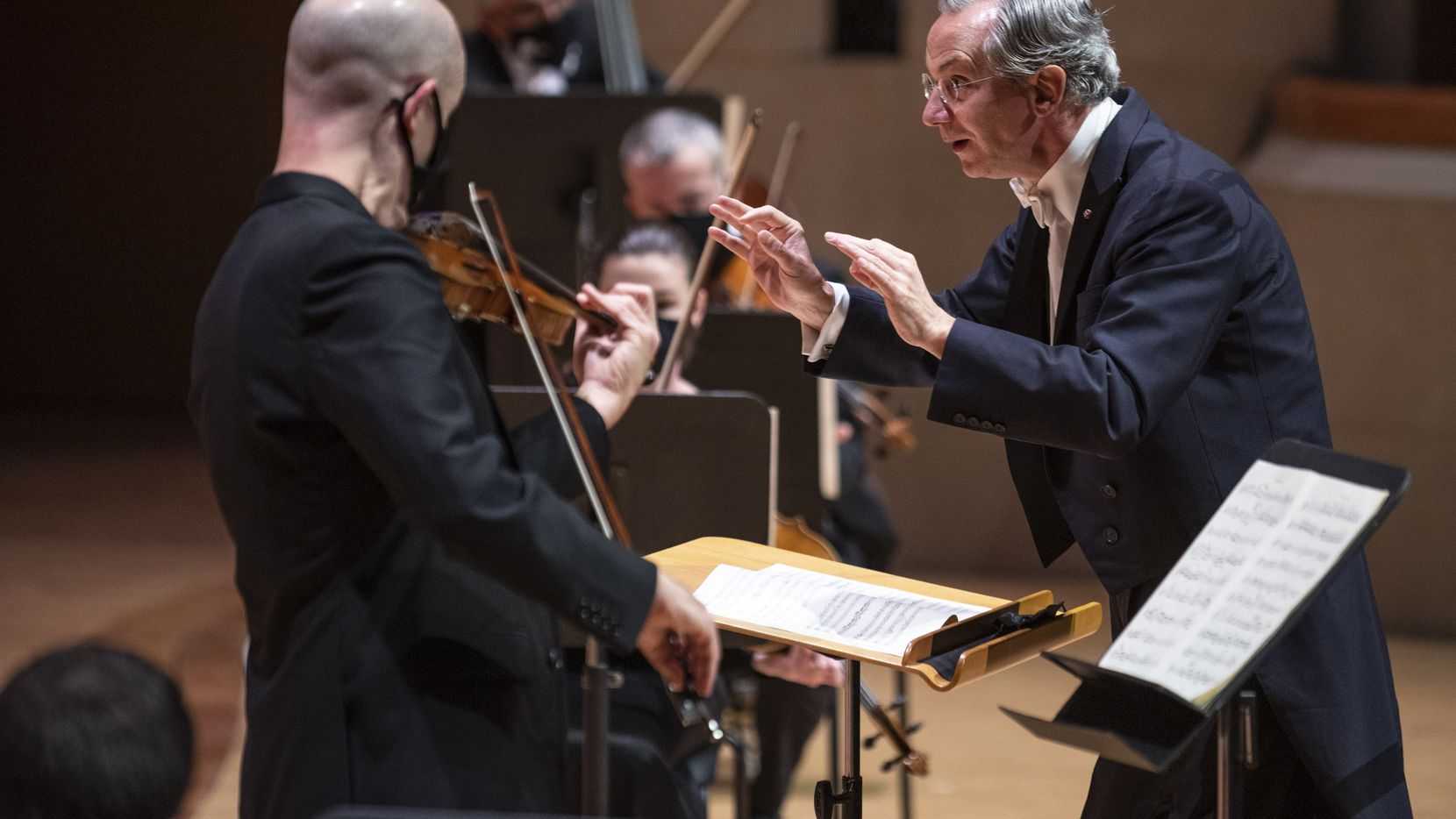 Fabio Luisi, Dallas Symphony Orchestra music director (right) conducts Mozart Concerto No. 3 for Violin and Orchestra in G Major, K. 216, with violinist Alexander Kerr (left)  on Friday, Feb. 19, 2021 at the Morton H. Meyerson Symphony Center in Dallas.