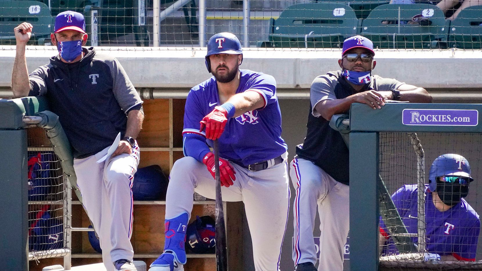 Texas Rangers manager Chris Woodward (left), outfielder Joey Gallo (center) and assistant hitting coach Callix Crabbe watch from the dugout during the third inning of a spring training game against the Arizona Diamondbacks at Salt River Fields at Talking Stick on Saturday, March 6, 2021, in Scottsdale, Ariz. (Smiley N. Pool/The Dallas Morning News)