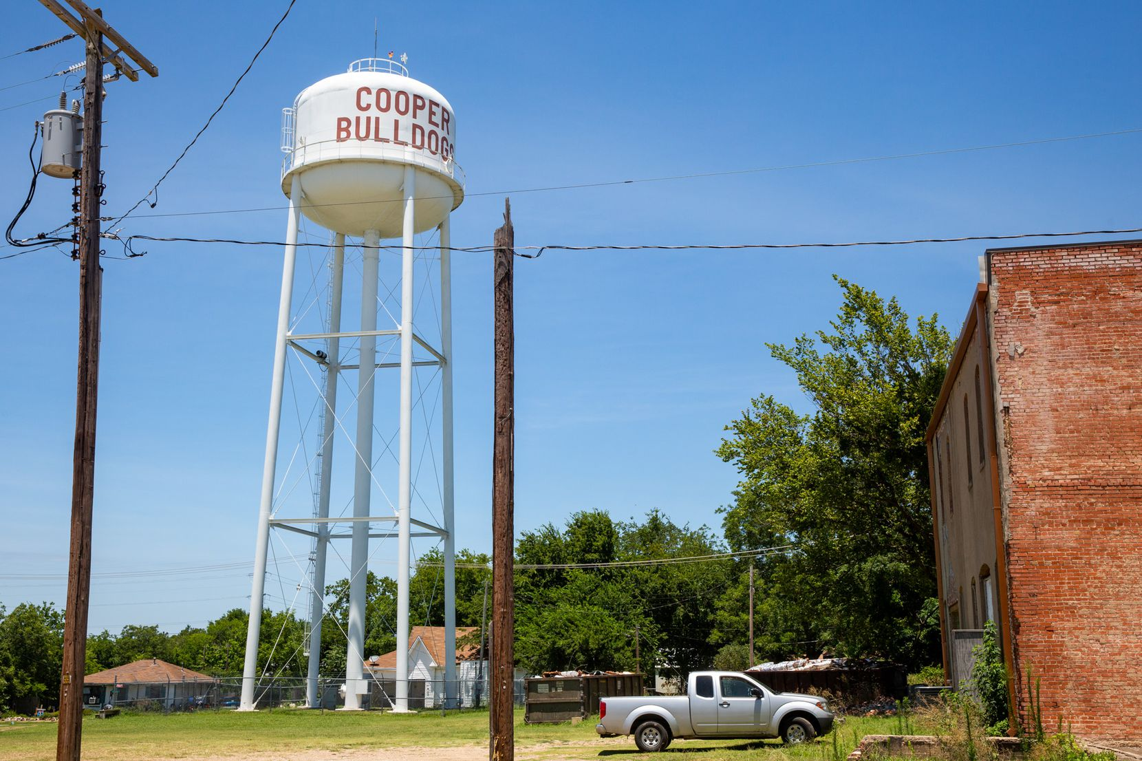 The water tower in Cooper, Texas, as seen on July 11, 2019. The Texas Department of Banking closed the local Enloe State Bank in late May 2019, and the former president has now pleaded guilty to conspiracy to commit bank fraud and arson for stealing from the bank.