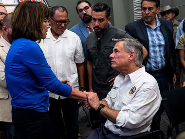 "State Rep. Evelina ""Lina"" Ortega of El Paso shook hands with Gov. Greg Abbott after a press briefing on the mass shooting at an El Paso Walmart in August 2019. In a tweet, the governor said he was working with El Paso legislators to ""identify solutions to keep El Paso and all Texans safer."""
