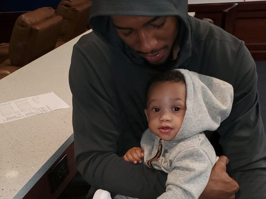 SMU forward Isiaha Mike holds his son, Kamryn. Mike entered the NBA draft process and has still yet to decide if he'll return to the Mustangs program.
