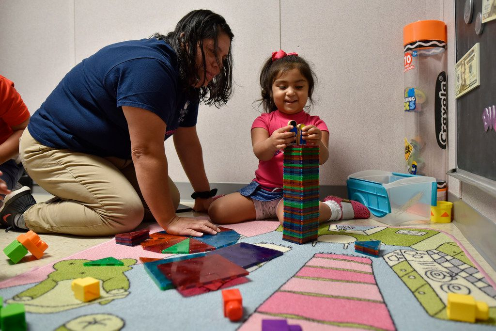 Patricia Vega works with her daughter Elizabeth Diaz, 3, on educational activities to help her understand colors at the Bachman Lake Together Family Center in Dallas.