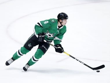 Dallas Stars defenseman Miro Heiskanen (4) turns the puck up ice against the Carolina Hurricanes during the first period at the American Airlines Center in Dallas, Tuesday, April 27, 2021.