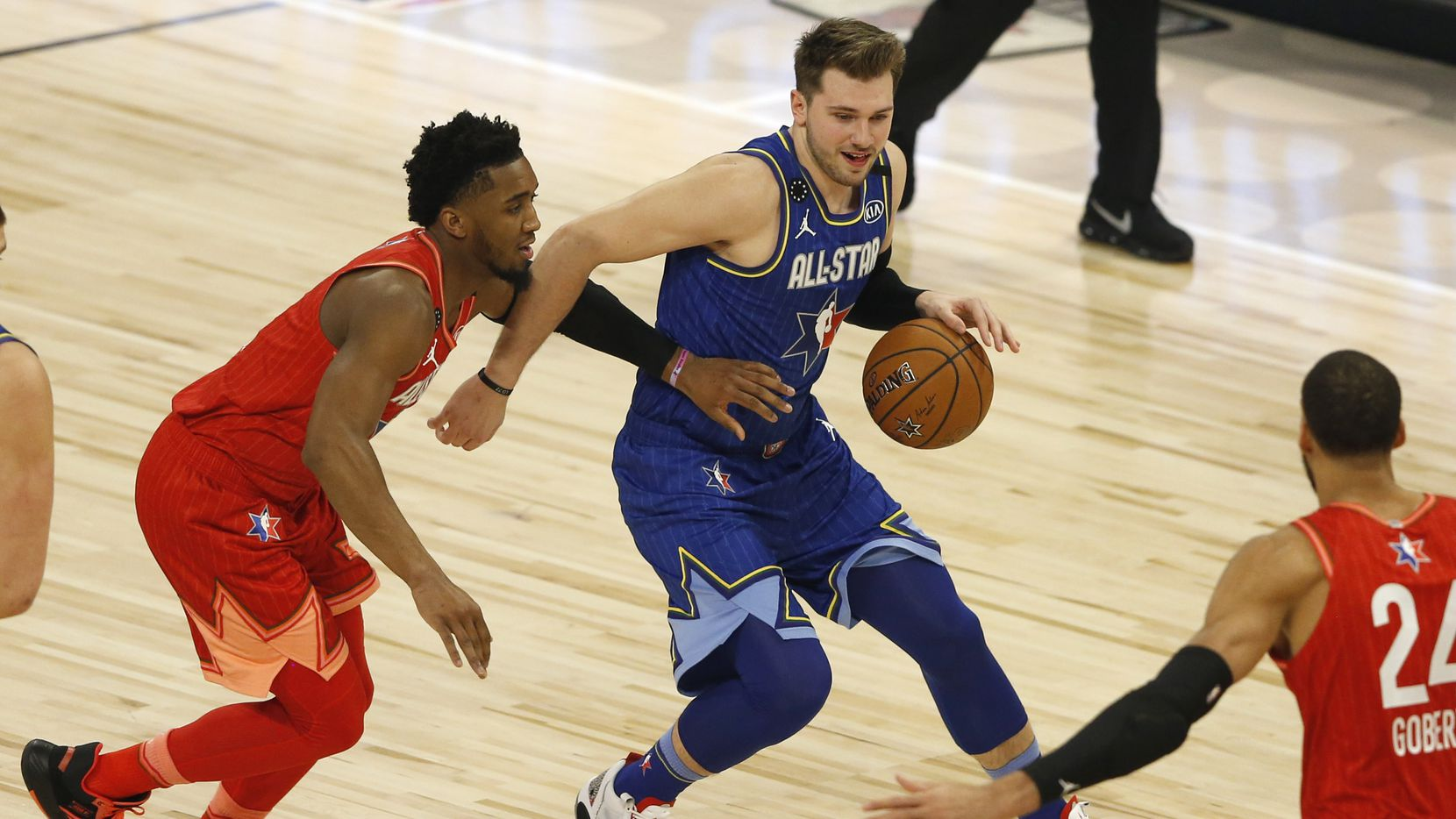 Team LeBron's Luka Doncic (2) dribbles past Team Giannis's Donovan Mitchell (24) toward Rudy Gobert (24) during the first half of play in the NBA All-Star 2020 game at United Center in Chicago on Sunday, February 16, 2020.