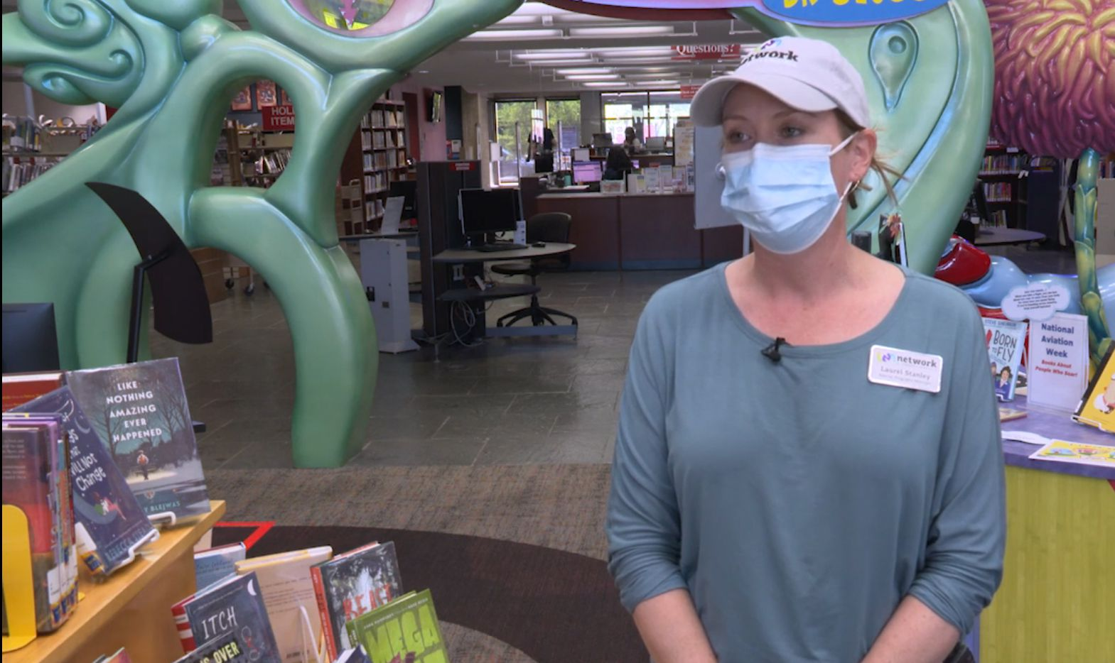 Laurel Stanley, special programs manager for the Network of Community Ministries, discusses the donation of 600 books to the non-profit by Friends of the Richardson Public Library.