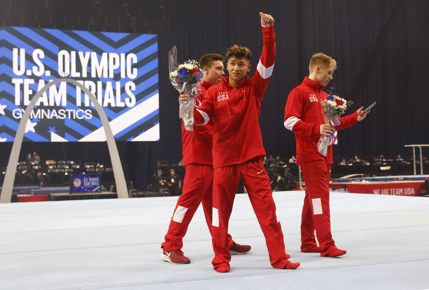 Yul Moldauer (center) acknowledges the crowd as he walks off the stage with Brody Malone (left) and Shane Wiskus (right), and Alec Yoder after the U.S. men's olympic team was introduced during day 2 of the men's 2021 U.S. Olympic Trials at America's Center on Saturday, June 26, 2021 in St Louis, Missouri.(Vernon Bryant/The Dallas Morning News)