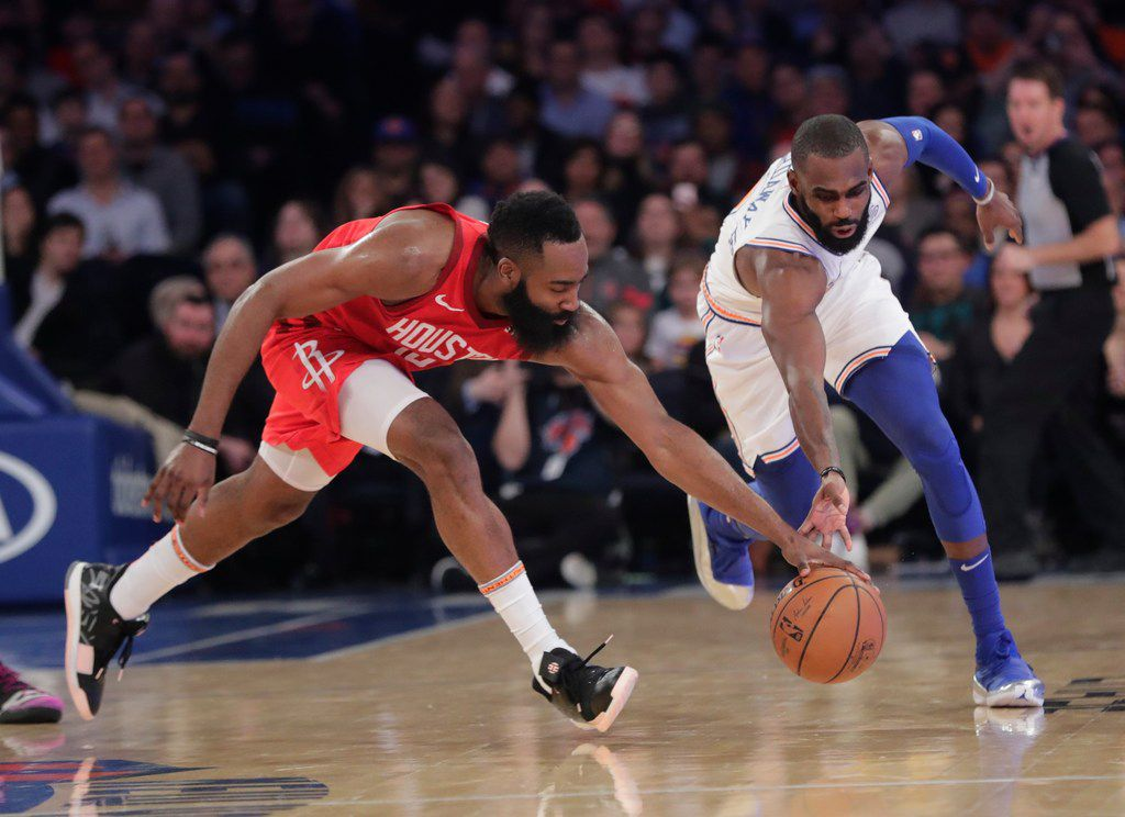 Houston Rockets' James Harden, left, and New York Knicks' Tim Hardaway Jr. reach for the ball during the second half of an NBA basketball game Wednesday, Jan. 23, 2019, in New York. The Rockets won 114-110. (AP Photo/Frank Franklin II)