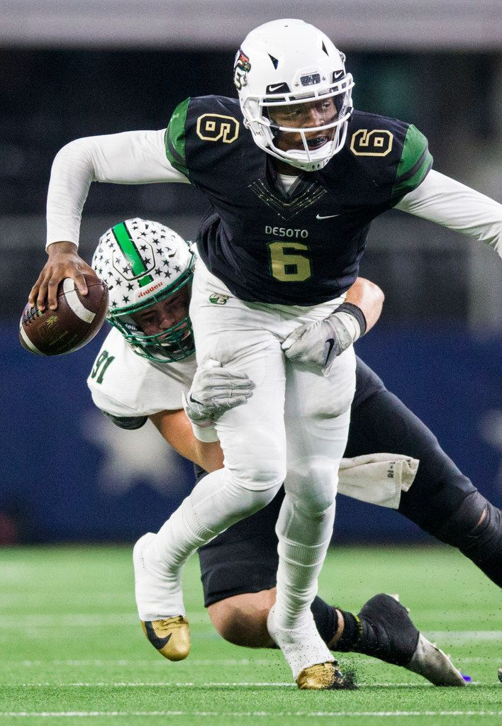 DeSoto quarterback Samari Collier (6) is tackled by Southlake Carroll defensive lineman Dillon Springer (91) during the third quarter of a Class 6A Division I area-round high school football playoff game between Southlake Carroll and DeSoto on Friday, November 22, 2019 at AT&T Stadium in Arlington. (Ashley Landis/The Dallas Morning News)