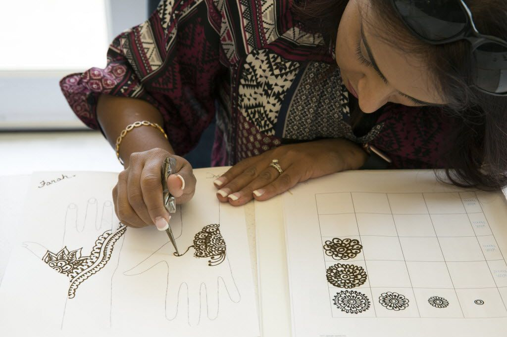 Farah Tharani practices henna in a basic henna class at Carrollton Public Library