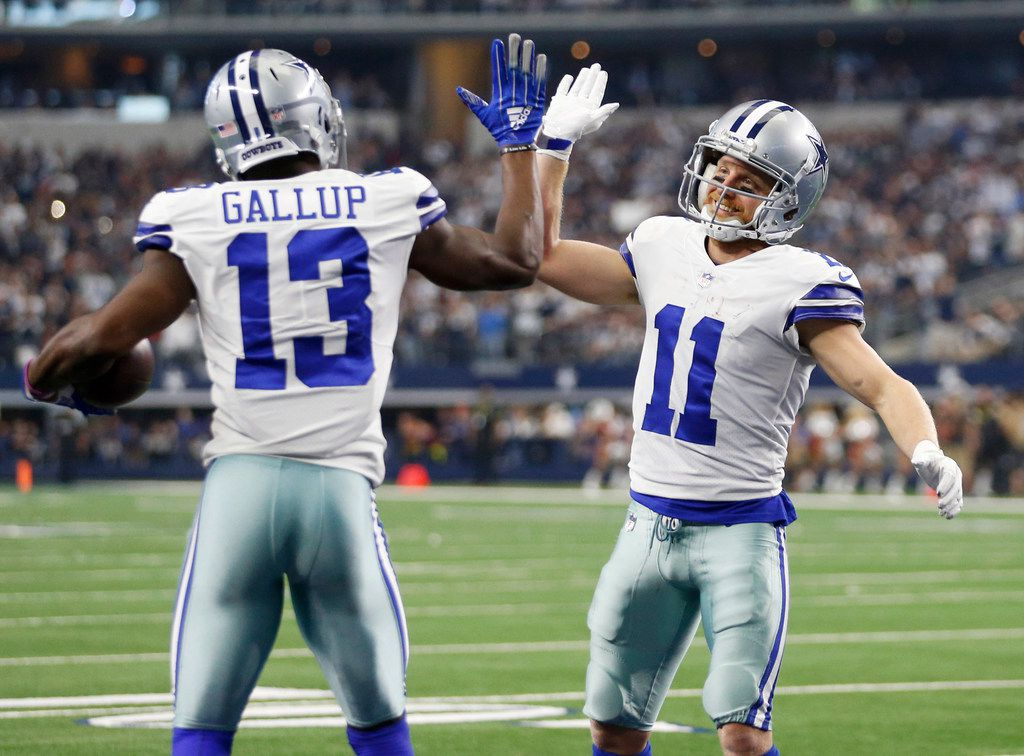 Dallas Cowboys wide receiver Michael Gallup (13) is congratulated by Dallas Cowboys wide receiver Cole Beasley (11) after Gallup scored a touchdown during the second half of play at AT&T Stadium in Arlington on Sunday, December 23, 2018. Dallas Cowboys defeated the Tampa Bay Buccaneers 27-20 to capture the NFC East. (Vernon Bryant/The Dallas Morning News)