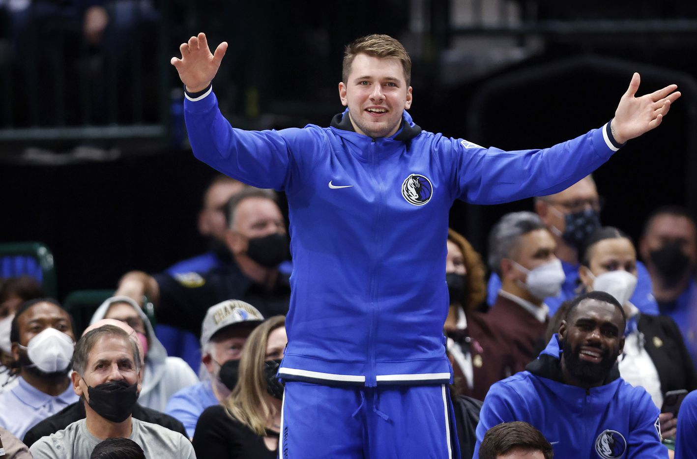 Dallas Mavericks guard Luka Doncic jumps out of his seat to celebrate a second half score against the Utah Jazz at the American Airlines Center in Dallas, Wednesday, October 6, 2021. The Mavericks defeated the Jazz, 111-101. (Tom Fox/The Dallas Morning News)