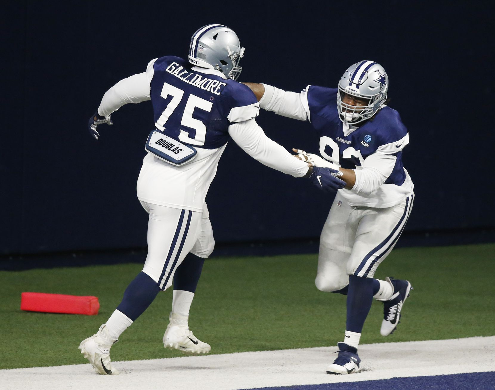 Dallas Cowboys defensive tackle Gerald McCoy (93) runs through a drill with Dallas Cowboys defensive tackle Neville Gallimore (75) during training camp at the Dallas Cowboys headquarters at The Star in Frisco, Texas on Monday, August 17, 2020. (Vernon Bryant/The Dallas Morning News)