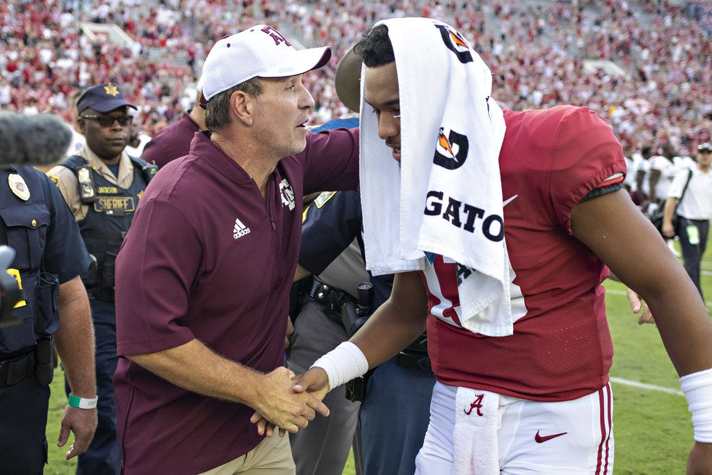 TUSCALOOSA, AL - SEPTEMBER 22:  Tua Tagovailoa #13 of the Alabama Crimson Tide shakes hands after the game with Head Coach Jimbo Fisher of the Texas A&M Aggies at Bryant-Denny Stadium on September 22, 2018 in Tuscaloosa, Alabama.  The Crimson Tide defeated the Aggies 45-23.