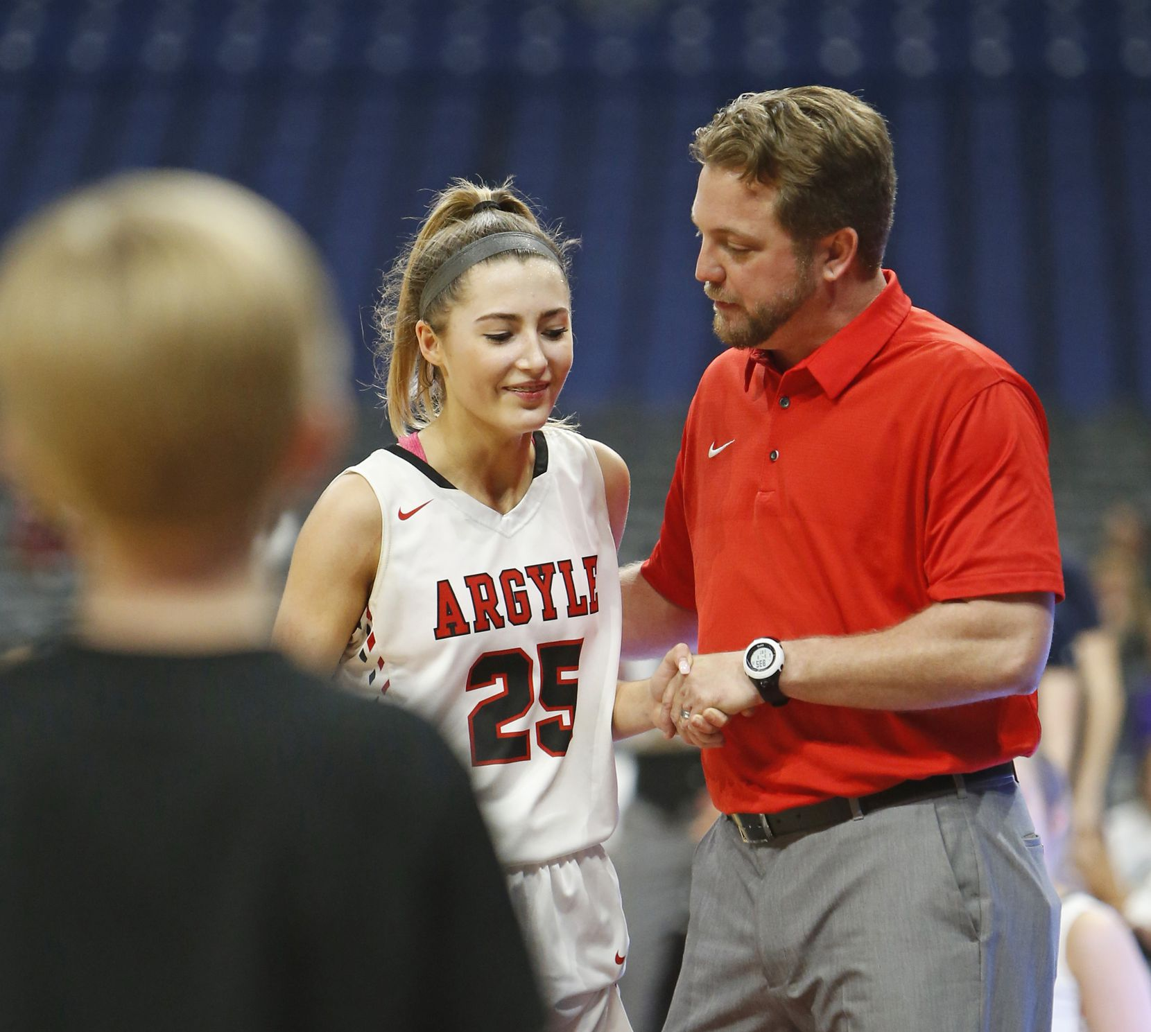 Argyle head coach Chance Westmoreland congratulates Argyle's Sydney Standifer in closing seconds. Argyle v San Antonio Veterans Memorial in a UIL girls basketball Class 4A on Saturday, March 3, 2018 at the Alamodome.  (Ronald Cortes/Special Contributor)