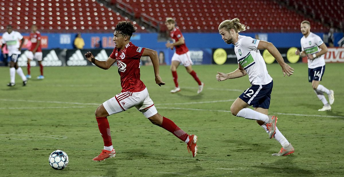 Jonathan Gomez rushes upfield with Greenville's Evan Lee in pursuit during the USL League One Final won by North Texas SC, October 19, 2019.