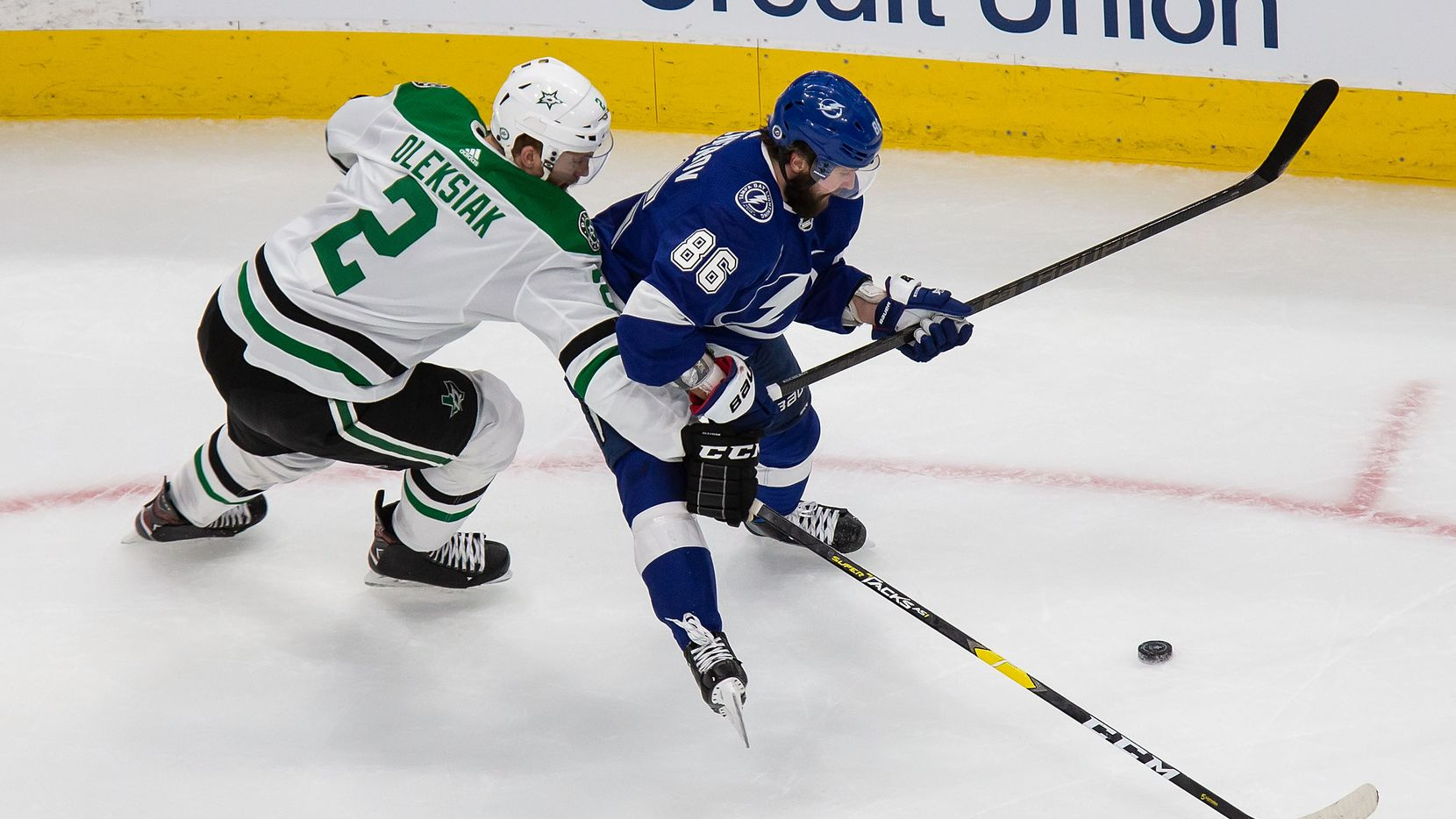 Jamie Oleksiak (2) of the Dallas Stars battles against Nikita Kucherov (86) of the Tampa Bay Lightning during Game One of the Stanley Cup Final at Rogers Place in Edmonton, Alberta, Canada on Saturday, September 19, 2020.