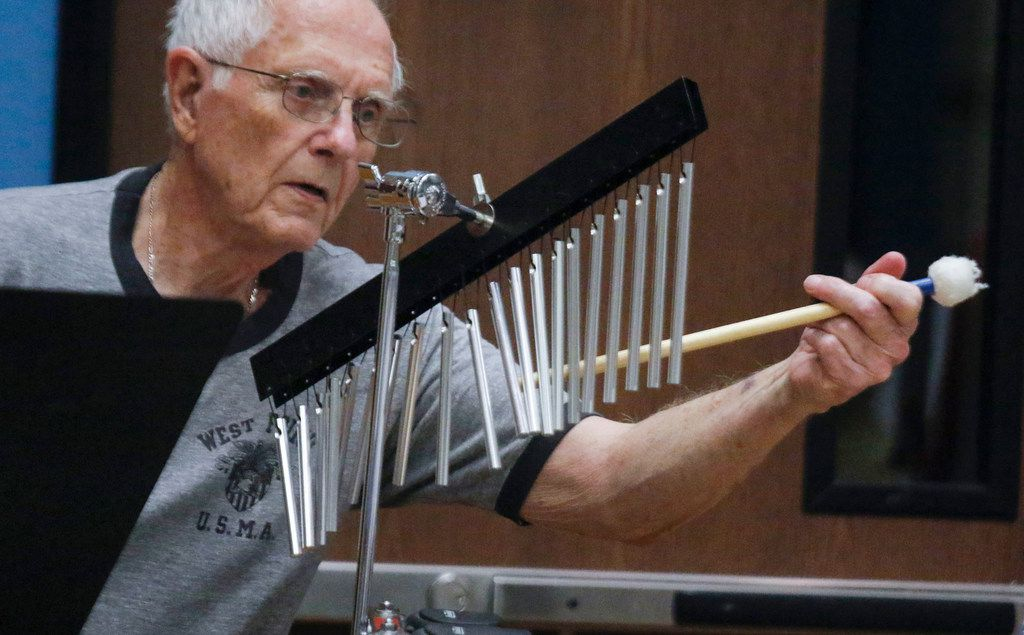 James Meine, 83, strikes a set of chimes at the Denton New Horizons Band rehearsal at the Denton Senior Center.He has been a percussionist since the 7th grade.