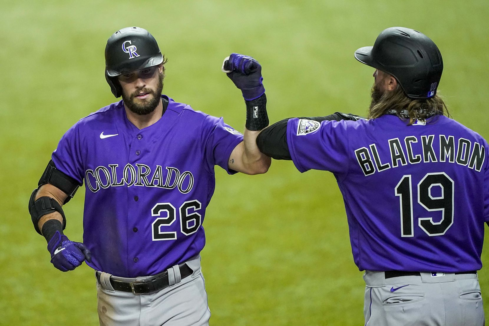 Colorado Rockies outfielder David Dahl celebrates with Charlie Blackmon after hitting a 2-run home run during the fifth inning of exhibition game against the Texas Rangers at Globe Life Field on Tuesday, July 21, 2020.