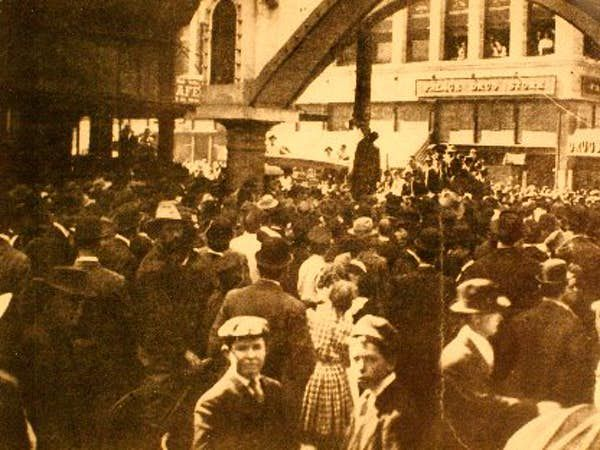 A portion of a postcard that depicted the public lynching of Allen Brooks in downtown Dallas in 1910.