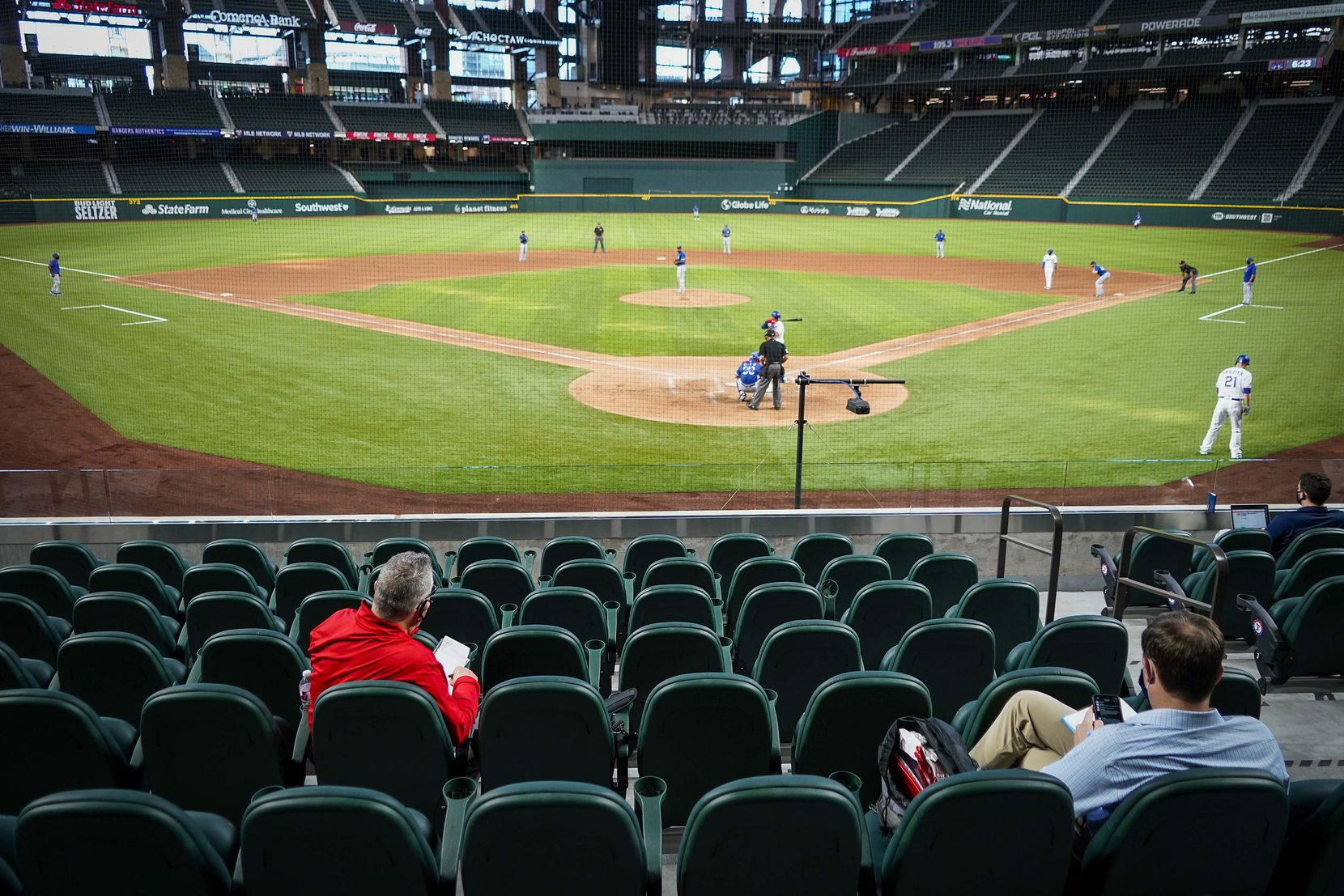 Scouts, including Senior Director of Amateur Scouting Kip Fagg (left) watch an intrasquad game during Texas Rangers Summer Camp at Globe Life Field on Thursday, July 16, 2020.