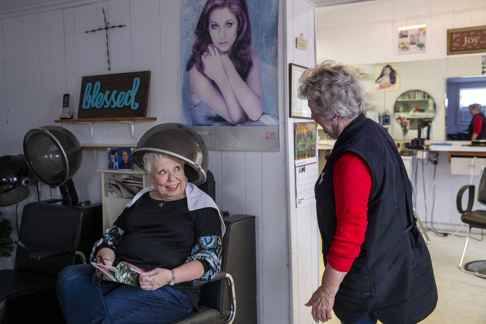 O'Neal sets client Joyce Farquhar into a hair dryer chair. O'Neal said she's not sure how much longer the shop will remain open if a developer goes through with plans to re-purpose her building.