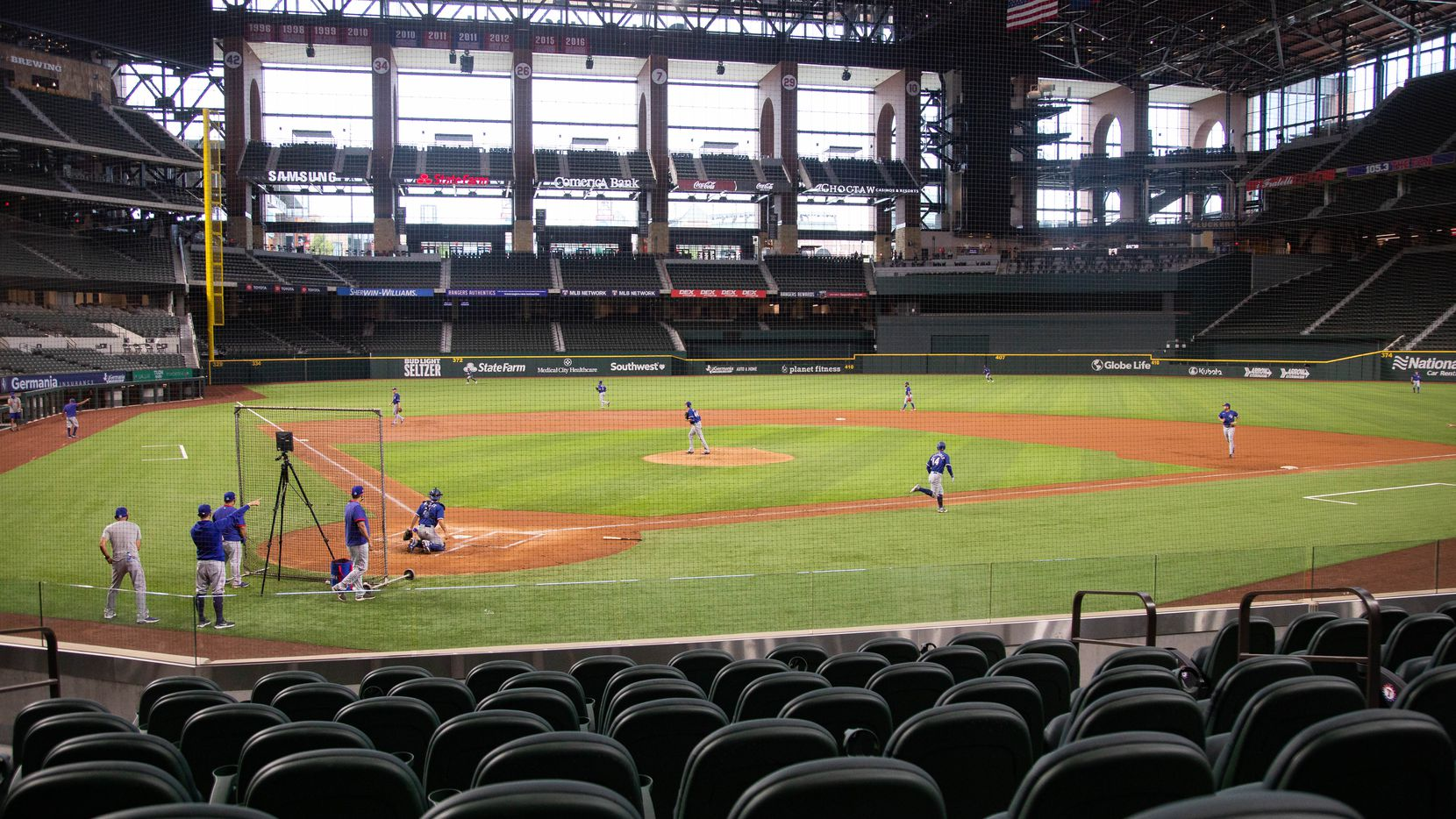 The Texas Rangers players play a simulated game during their third Summer Camp workout on July 5, 2020 in Arlington.