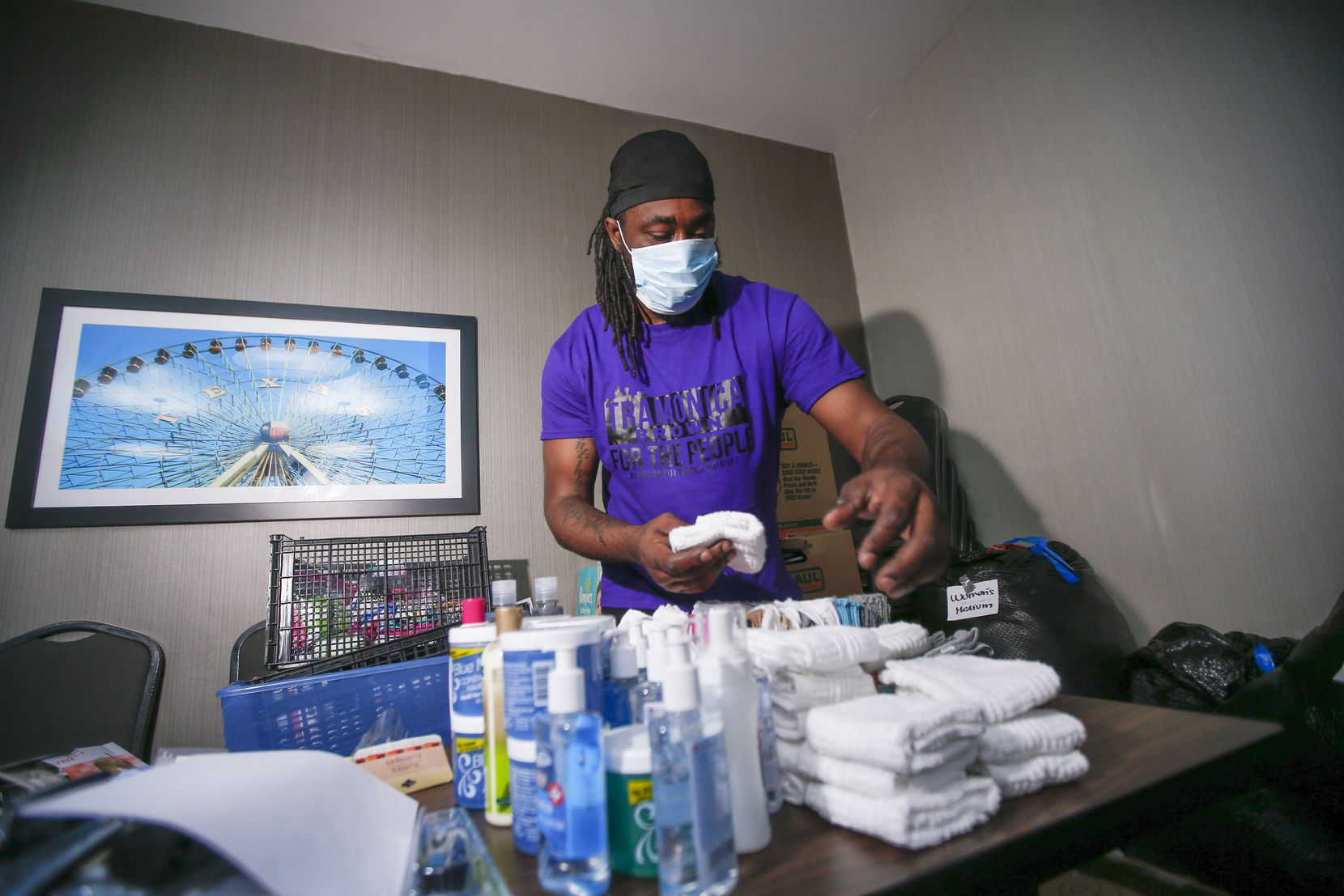 Dominique Robinson, one of the people being helped by Not My Son Dallas, does what he can to help the aid operation. Here, he sorts donated toiletries.