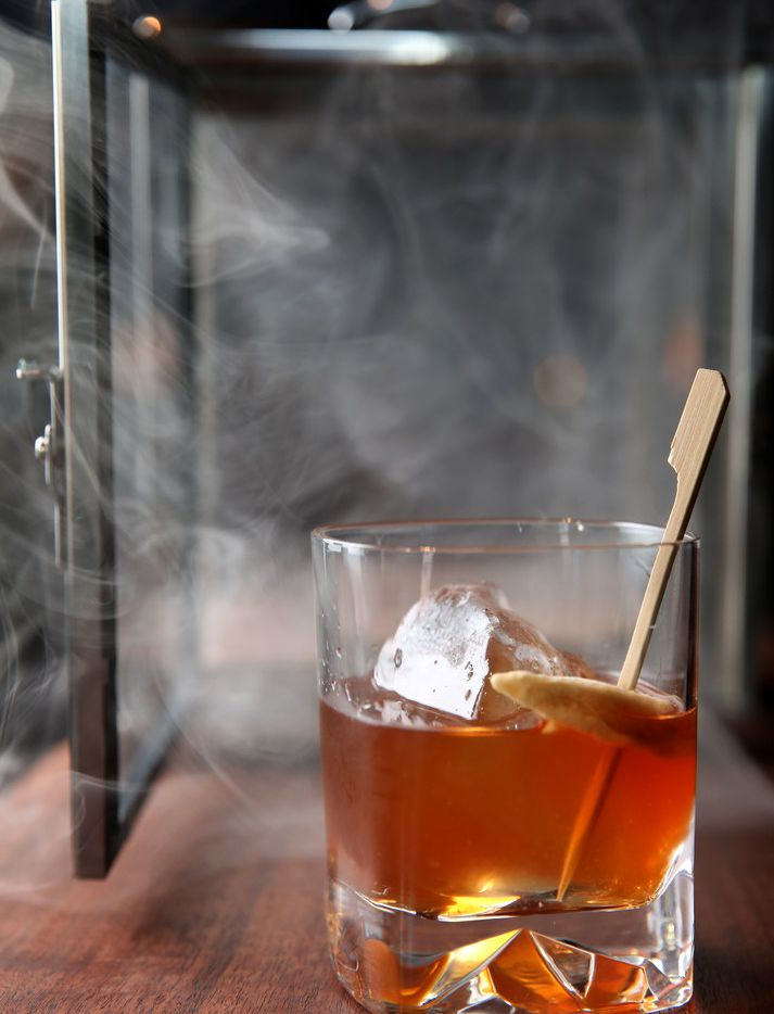 Smoked Old Fashioned at Haywire in Plano, Texas on Thursday, Nov. 30, 2017. (Rose Baca/The Dallas Morning News)