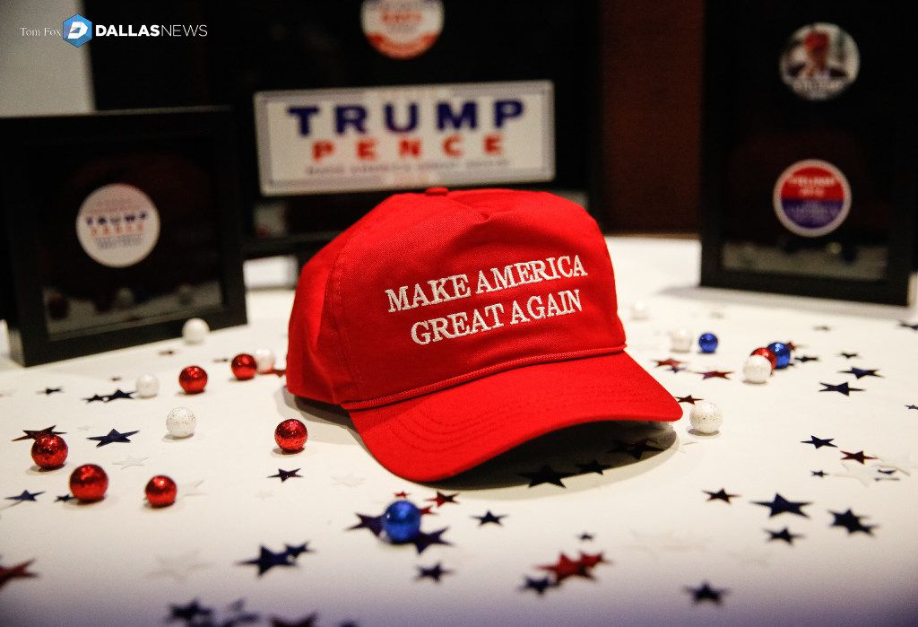 Donald Trump's signature hat, Make America Great Again, is pictured on a table at an election party at the Midtown Hilton in New York City.