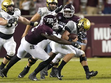 Vanderbilt quarterback Ken Seals, right, is sacked by Texas A&M's Micheal Clemons (2) McKinnley Jackson during the second half of an NCAA college football game Saturday, Sept. 26, 2020, in College Station, Texas. Texas A&M won 17-12. (AP Photo/David J. Phillip)