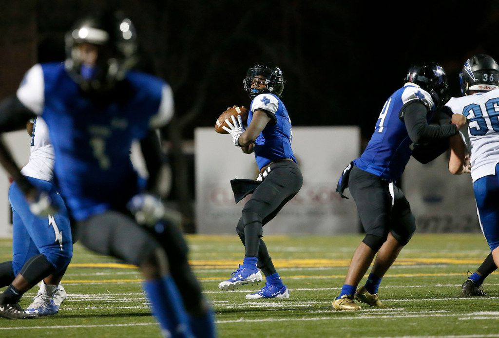 Trinity Christian-Cedar Hill quarterback Shedeur Sanders (2) throws a pass downfield during the first half against Dallas Christian in a TAPPS Division II State Playoff game at Highlander Stadium in Dallas, Saturday, Dec. 2, 2017. (Jae S. Lee/The Dallas Morning News)