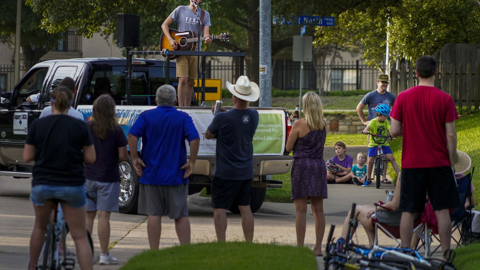 Cameron Havens sings from the back of a pickup truck during a 'Drive By Concert' through the Canyon Creek subdivision on Thursday, July 2, 2020, in Richardson. The neighborhood was named one of the best places in Texas to buy a home.