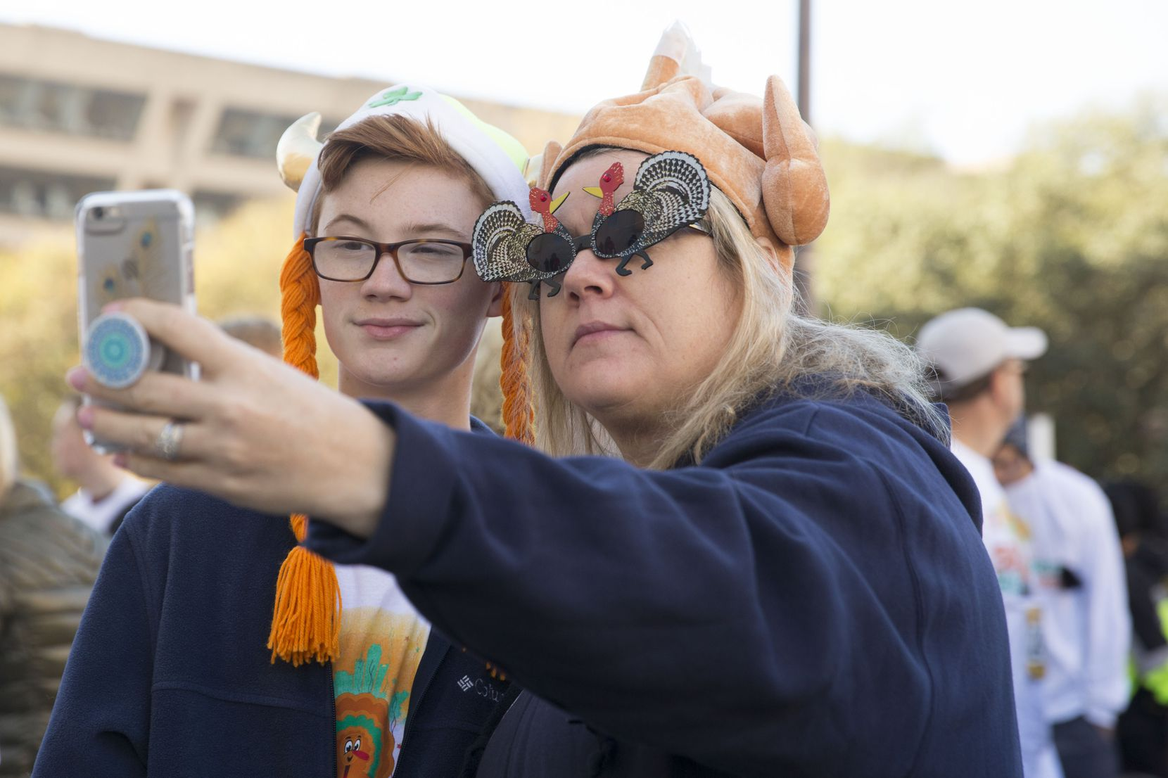 Stacie Collins (right) and nephew Colin Sumrall take a selfie before the Dallas YMCA Turkey Trot, held annually on Thanksgiving.