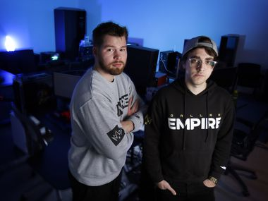 "FILE - Dallas Empire players Ian ""Crimsix"" Porter (left) and James ""Clayster"" Eubanks pose for a photo in the team's new Dallas offices in Victory Park on Wednesday, Jan. 15, 2020."