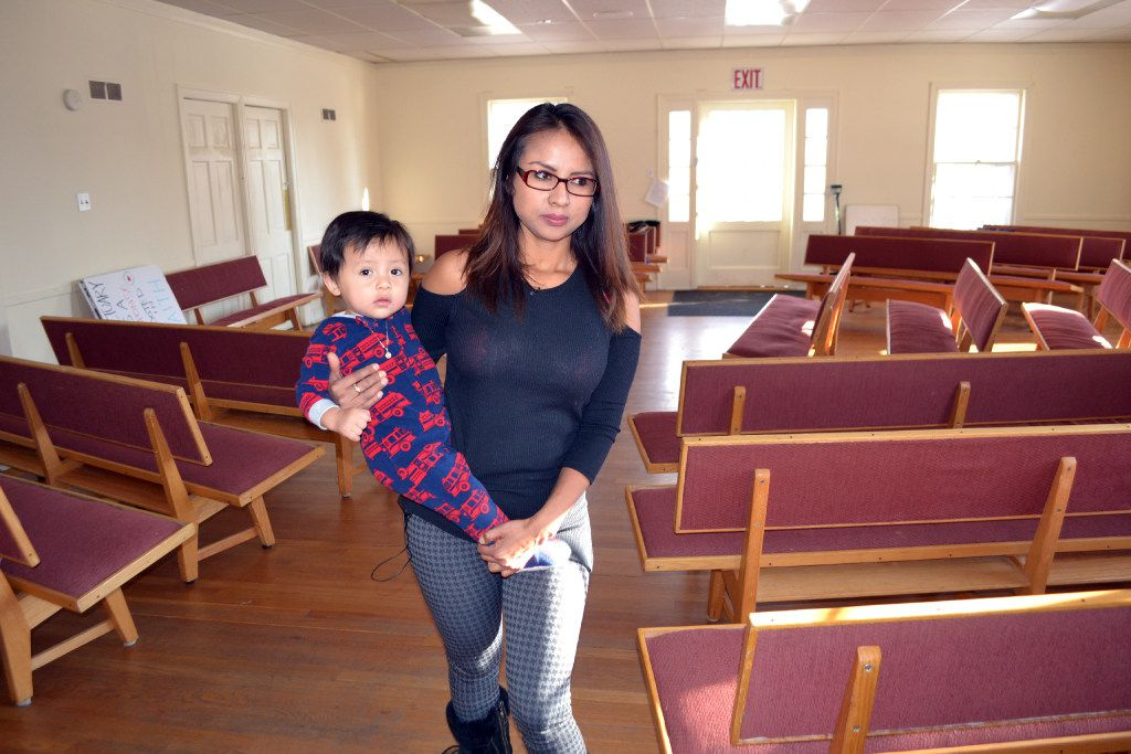 In this photo from December, Ingrid Encalada Latorre holds her one-year-old son at a Denver Quaker center, the Mountain View Friends Meeting. She has taken sanctuary there as she tries to exhaust every legal remedy to stay in the U.S. (P. Solomon Banda/Associated Press)