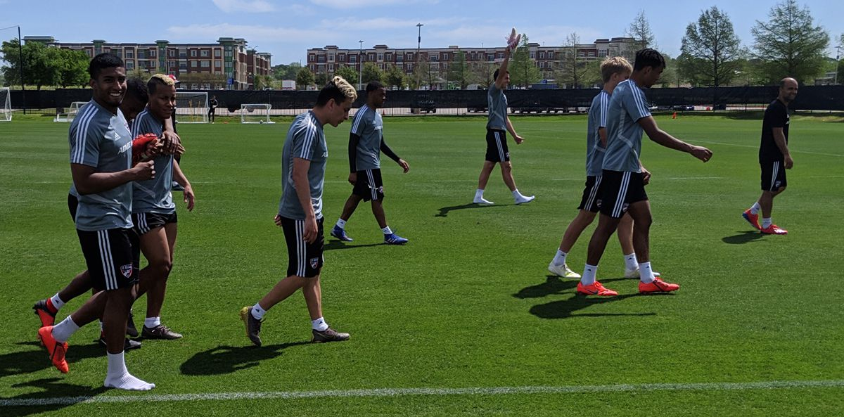 Santiago Mosquera (front left) is all smiles as the team exits Wednesday training. (4-10-19)