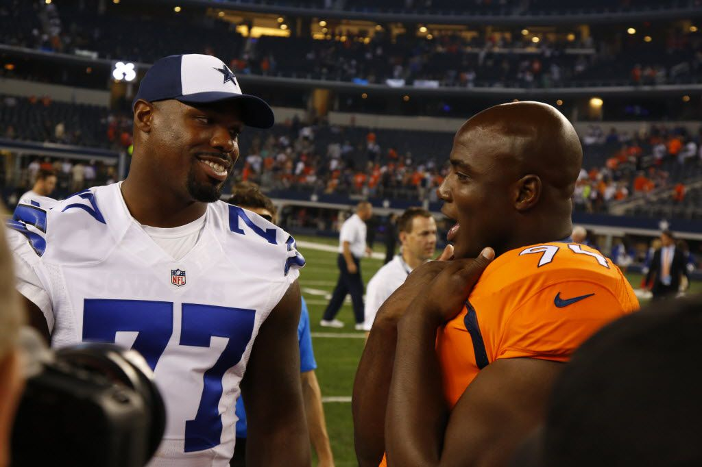 Former Dallas Cowboys Denver Broncos defensive end DeMarcus Ware (94) talks to Dallas Cowboys tackle Tyron Smith (77) after  the last half  in a preseason game at AT&T Stadium in Arlington on Thursday August 28, 2014. (Nathan Hunsinger/The Dallas Morning News)