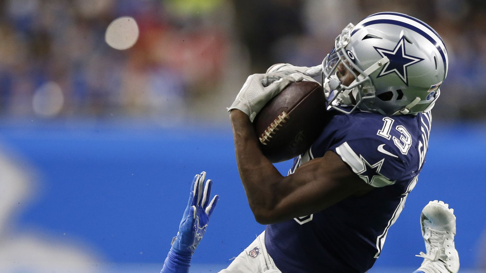 Dallas Cowboys wide receiver Michael Gallup (13) catches a pass in front of Detroit Lions defensive back Mike Ford (38) during the first half of play at Ford Field in Detroit, on Sunday, November 17, 2019. (Vernon Bryant/The Dallas Morning News)