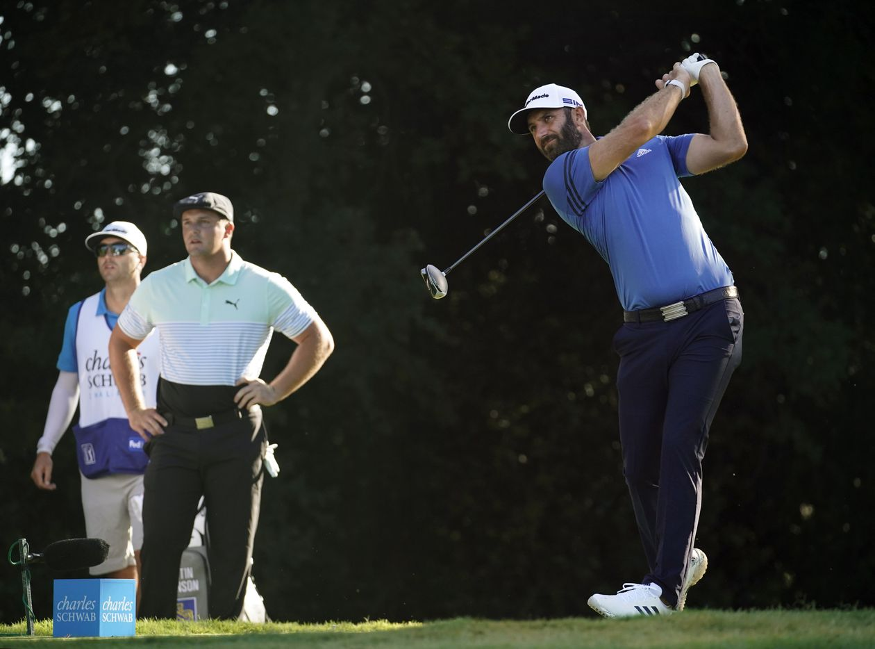 PGA golfer Dustin Johnson follows through on his drive on No. 12 during the opening round of the Charles Schwab Challenge at the Colonial Country Club in Fort Worth, Thursday, June 11, 2020. The Challenge is the first tour event since the COVID-19 pandemic began. (Tom Fox/The Dallas Morning News)