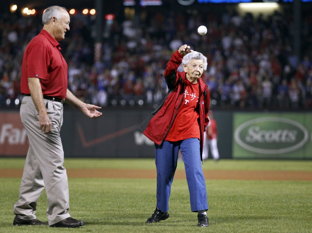 Sister Frances Evans throws out the ceremonial first pitch with the escort by Texas Rangers owner Nolan Ryan before the American League Wild Card playoff game at Rangers Ballpark in Arlington in October 2012.    (Tom Fox/The Dallas Morning News)