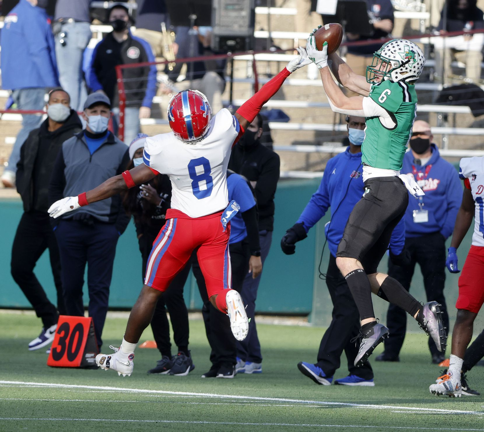 Southlake receiver Landon Samson (6) grabs a touchdown pass in front of Duncanville defender Jadarius Thursby (8) during the Class 6A Division I state high school football semifinal in Arlington, Texas on Jan. 9, 2020. (Michael Ainsworth)