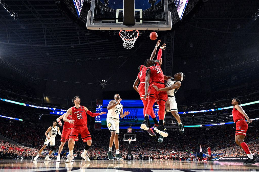MINNEAPOLIS, MINNESOTA - APRIL 06: Cassius Winston #5 of the Michigan State Spartans drives to the basket against Norense Odiase #32 and Tariq Owens #11 of the Texas Tech Red Raiders in the second half during the 2019 NCAA Final Four semifinal at U.S. Bank Stadium on April 6, 2019 in Minneapolis, Minnesota. (Photo by NCAA Photos - Pool/2019 Getty Images)
