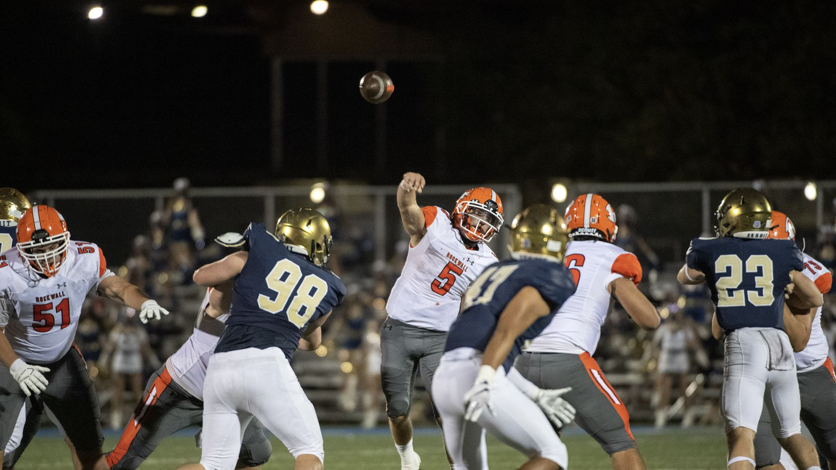 Rockwall junior quarterback Lake Bennett (5) throws a pass in the second half of a high school football game against Jesuit on Friday, October 2, 2020 at Postell Stadium in Dallas. Rockwall won 60-38.