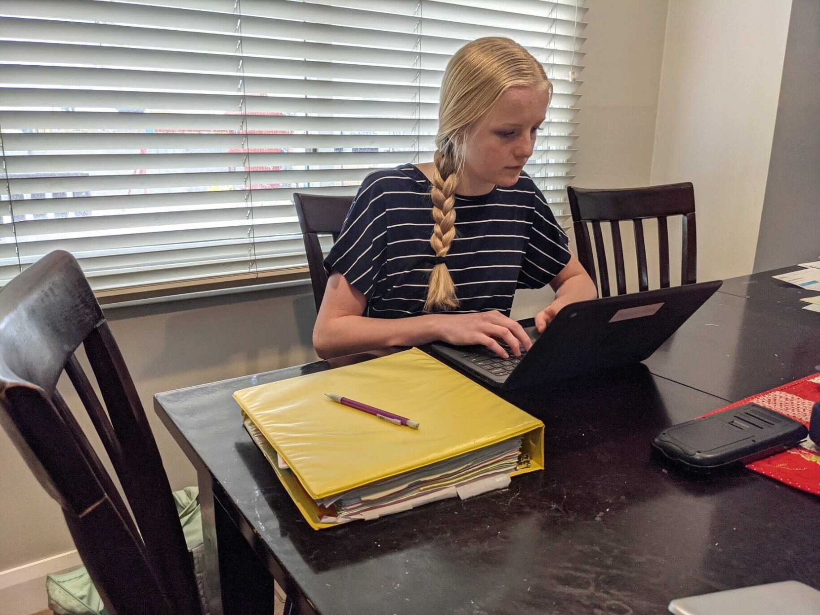 "Ninth grader Kate Bowen completes homework in her family's dining room with the help of Murray City School District's broadband network. The Utah district hopes to expand access to all 6,000 students by mid-April. ""This will be part of our Murray culture now,"" says Superintendent Jennifer Covington."